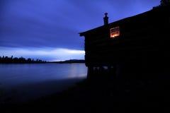 Vieille cabine après coucher du soleil Photos stock