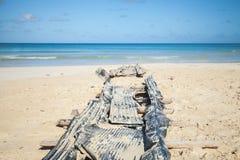 Vieille cale abandonnée sur la plage du Macao Photographie stock