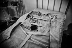 Vieille camisole de force psychiatrique photographie stock libre de droits