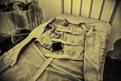 Vieille camisole de force psychiatrique images libres de droits