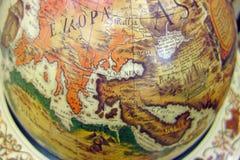 Vieille carte du monde sur le globe Photographie stock libre de droits