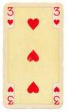 Vieille carte jouante avec trois coeurs Photos libres de droits