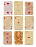 Vieille carte jouante utilisée de collection des milieux de papier de coeurs d'isolement Photographie stock libre de droits