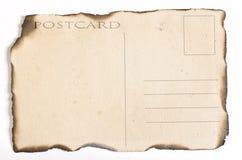 Vieille carte postale avec les bords brûlés Photos libres de droits