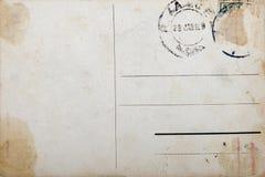 Vieille carte postale, papier grunge avec des repères de vieillissement Photographie stock libre de droits