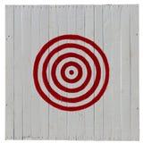 Vieille cible rouge sur le fond blanc de planches Photographie stock libre de droits