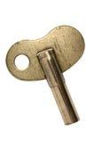 Vieille clé en laiton d'horloge Images stock