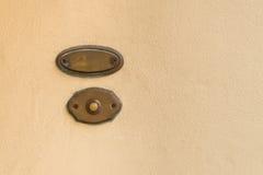 Vieille cloche de porte de vintage avec la plaque d'identification vide Photos stock