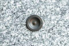 Vieille cloche de porte de vintage avec le fond en pierre Photo stock