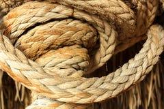 Vieille corde roulée Photos stock