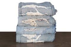Vieille correction de jeans et plié images libres de droits