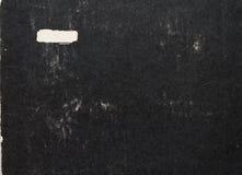 Vieille couverture de papier noire de livre Photographie stock