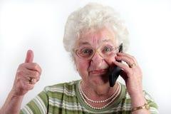 Vieille dame avec le téléphone portable Images stock