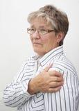Vieille dame en douleur Photographie stock