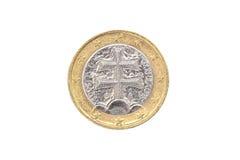 Vieille employée et porté 1 euro pièce de monnaie Image libre de droits