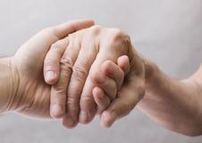 Vieille et jeune main Photos libres de droits