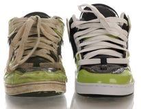 Vieille et neuve chaussure de course Image libre de droits