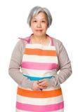 Vieille femme au foyer asiatique images stock
