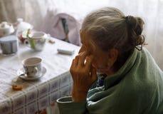 Vieille femme seule Photographie stock