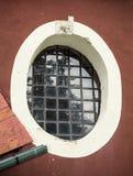 Vieille fenêtre barrée Photographie stock