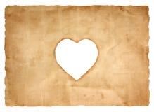 Vieille feuille de papier avec le symbole de coeur pour le fond Photos stock