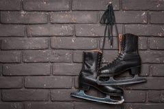 Vieille figure noire patins de glace Photos libres de droits