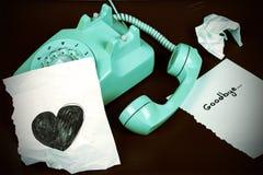 Vieille forme de téléphone et de coeur Image stock