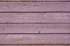 Vieille frontière de sécurité en bois pourprée. Photographie stock