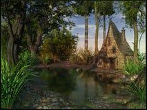Vieille hutte près de l'étang Photos stock