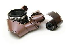 Vieille lentille avec la bande de film Photographie stock libre de droits