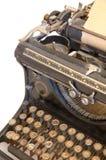 Vieille machine à écrire avec une feuille de papier Images stock