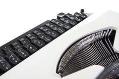 Vieille machine à écrire se reposant sur une table Images stock