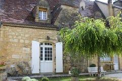 Vieille maison dans le village de Castelnaud Photographie stock libre de droits