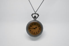 Vieille montre de poche accrochée Photos stock