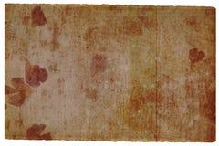 Vieille page brune avec le détail de fleur Image libre de droits