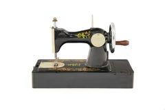 Vieille petite machine à coudre noire Photos stock