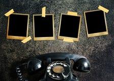 Vieille photo et vieux téléphone Image libre de droits