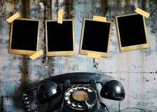 Vieille photo et vieux téléphone Image stock