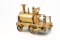 Vieille pièce d'or de dos de jouet de locomotive à vapeur Photographie stock