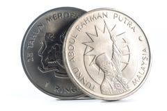 Vieille pièce de monnaie malaisienne sur un fond blanc Images libres de droits