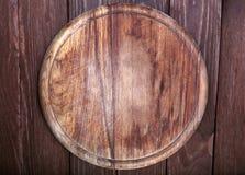 Vieille planche à découper en bois de forme ronde Photo libre de droits