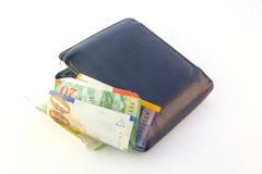 Vieille pochette avec de l'argent Photo stock