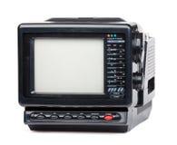 Vieille radio et téléviseur tenus dans la main d'isolement Photographie stock