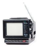 Vieille radio et téléviseur tenus dans la main d'isolement Photographie stock libre de droits