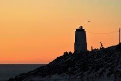 Vieille roche de phare Photos stock