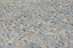 Vieille route de pavé rond pavée avec des pierres Photographie stock