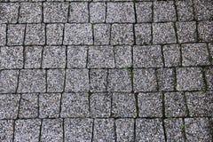 Vieille surface chinée de granit de pavé rond images stock