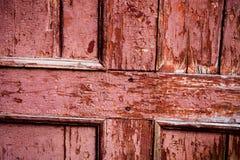 Vieille surface en bois avec la huile-peinture rose criquée Photo libre de droits
