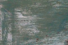 Vieille surface métallique peinte avec la peinture verte avec des courses de la peinture blanche photographie stock