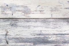 Vieille texture en bois blanche, avec une surface approximative de petites fissures et de peinture ébréchée Images stock